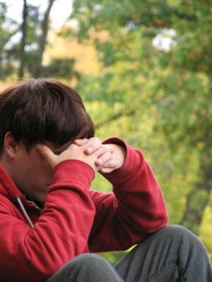 stressed man seeks medicines from online pharmacy