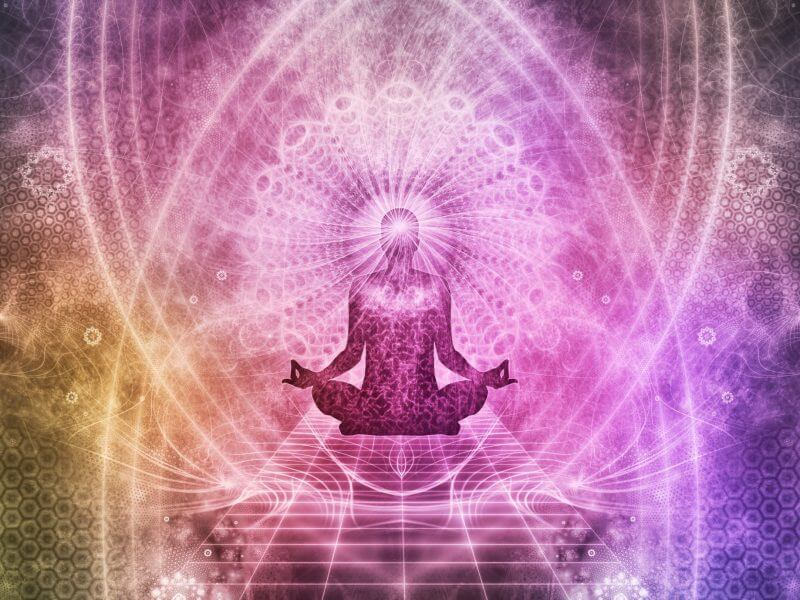 Psychedelic pink & purple image showing someone practicing yoga and mindfulness.
