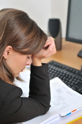 young woman suffering from headache searches for online pharmacy