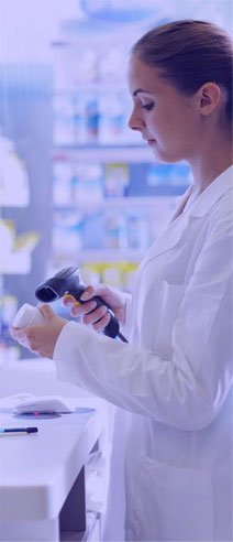 Pharmacist from canadian pharmacy scanning prescription drug bottle